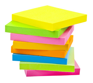 Stack of Sticky Note Pads over a white background.